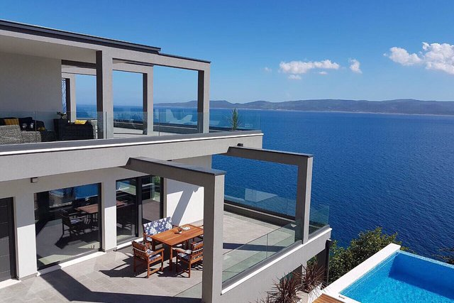 HI-TECH modern villa on the FIRST LINE to the sea by solitary beach on Omis riviera!