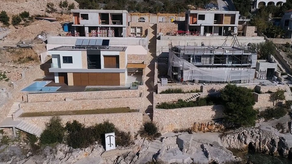 Four modern villas with pools at the construction stage in an amazingly efficient location in the outskirts of Trogir!