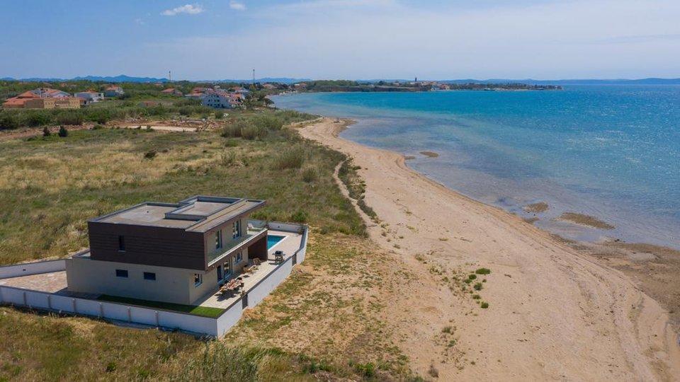 MODERN VILLA LOCATED BY THE SANDY BEACH IN PRIVLAKA!